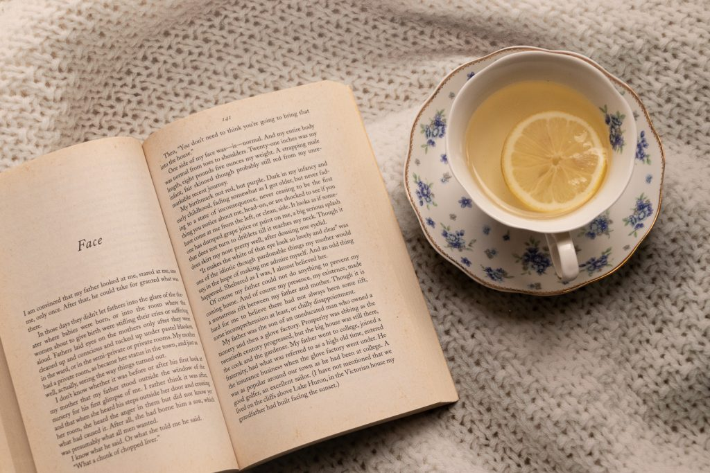 open book with tea cup